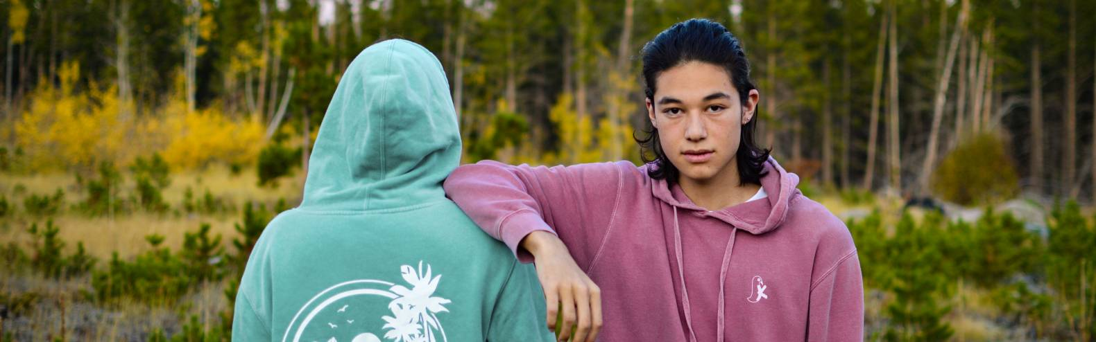models in hoodies with fall aspens